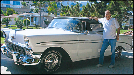 Michael Delees standing in front of his 1956 Chevy Bel-Air